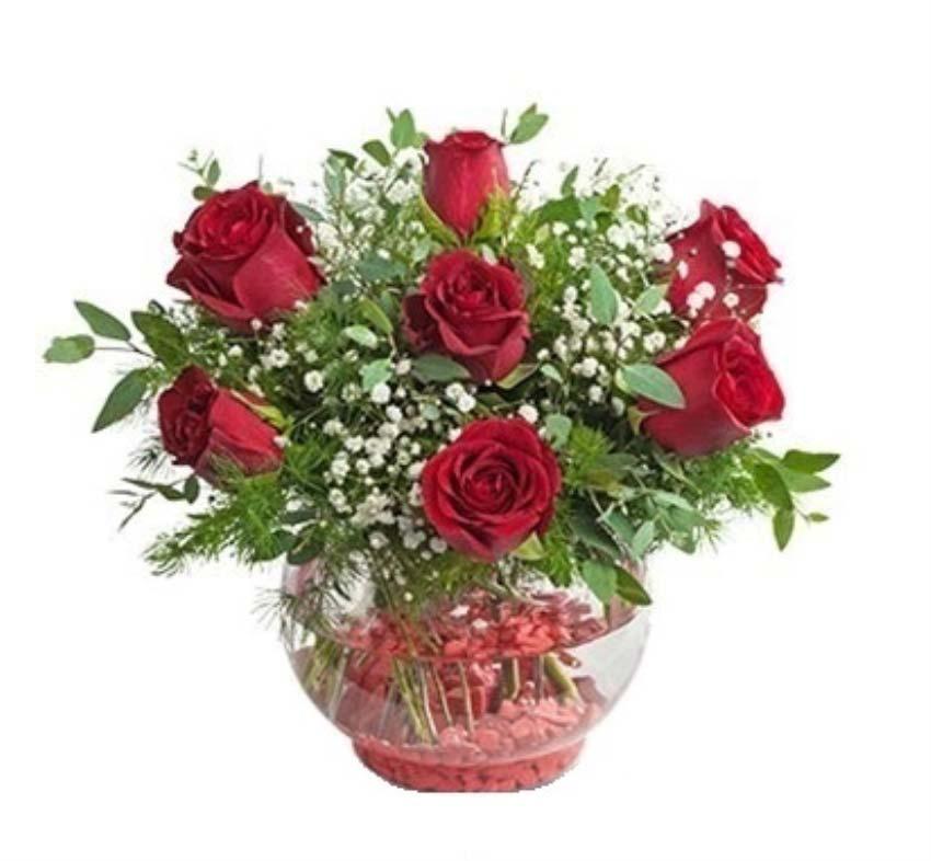 Bizim aşkımız fırtınalara bile dayanır. Cam vazo içerisinde 7 adet kırmızı güllerden oluşan arajman